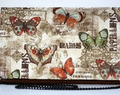 Vinatge clutch with multicolored butterflies on beige fabric, stylish bag for special occasions