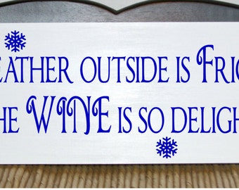 The weather outside is frightful but the wine is so delightful wood sign