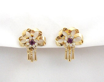 Gilded metal dangle bow shaped vintage earrings embellished with rhinestones from Fifties