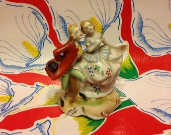 Vintage hand painted ceramic colonial couple figurine- Japan