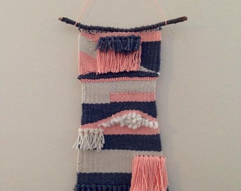Gray, pink, and cream weaving