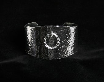 Wide cuff bracelet 'Story of O' BDSM O ring bracelet. Traditionally handmade with hand hammered finish. Fully UK Hallmarked Sterling Silver.