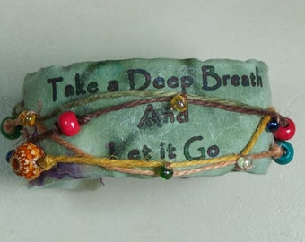 Take a deep breathe and let it go. Something we all need to do at times. Inner Peace cuff bracelet