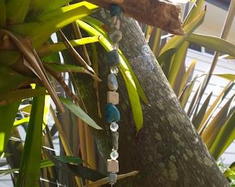Blue marbelized porcelain bead sea horse sun catcher