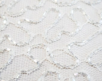 Hand beaded white tulle lace fabric