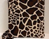 "Conceal Carry Messenger Bag. Fabric, Giraffe print, adjustable strap. Measures 11"" x 9-1/2""."