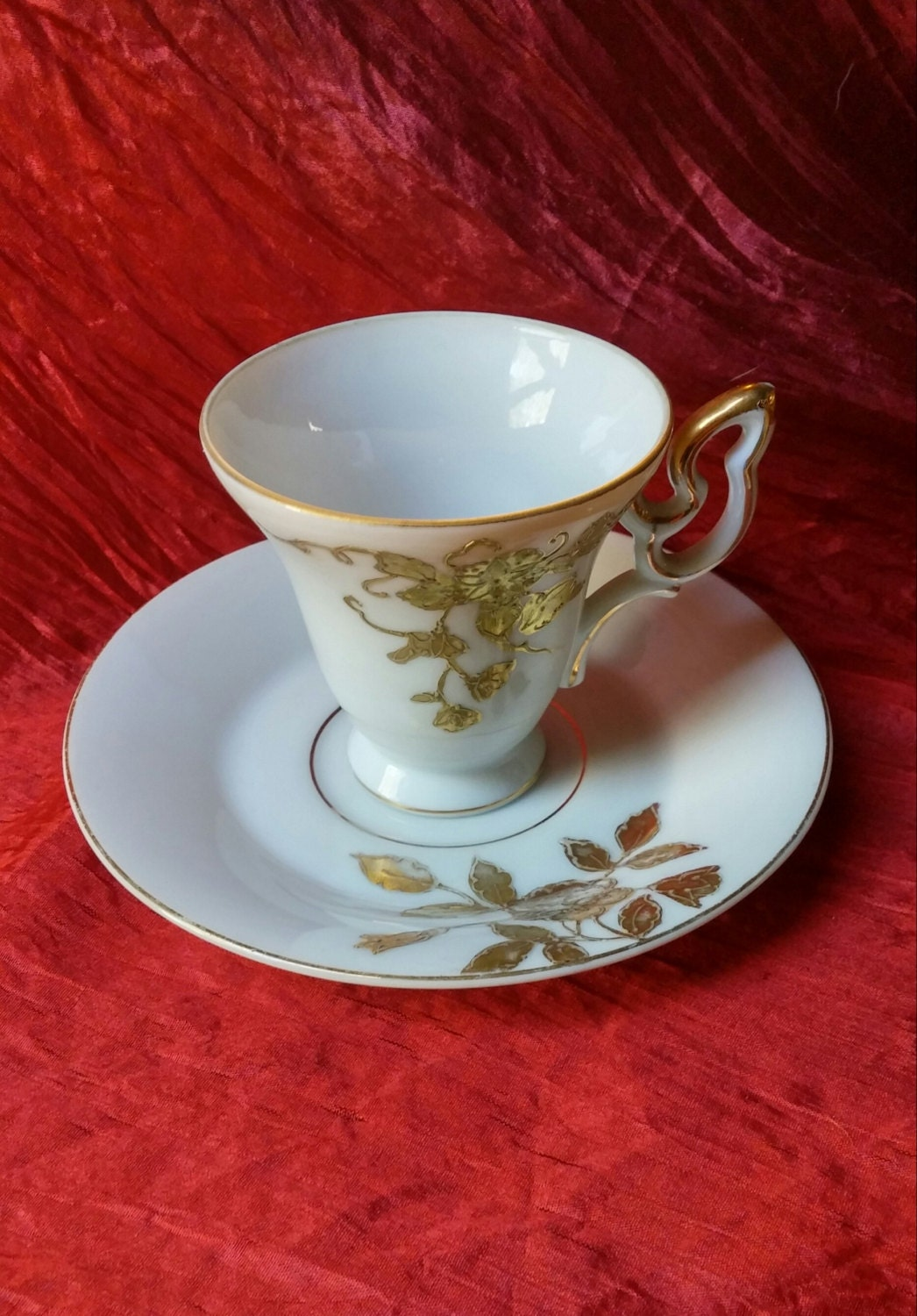 demitasse cup and saucer with gold floral pattern on white. Black Bedroom Furniture Sets. Home Design Ideas