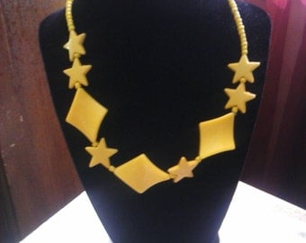 Vintage Yellow  stars resin necklace.