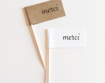 """12 """"MERCI"""" Toppers"""