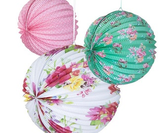 3 x Trendy paper lanterns each with a different floral design and color.
