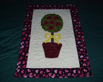 Valentine's Day is right around the corner. This quilt is machine quilted and appliqued and ready to hang.