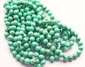 "15"" Strand Turquoise 12mm round Beads"
