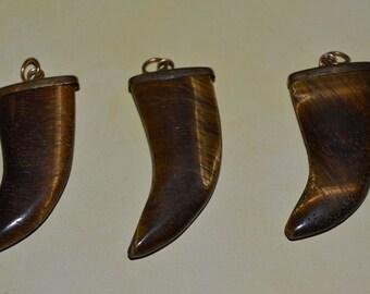Vintage Tigereye Tusk shaped pendants.(1060210)