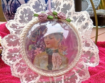 Three inch ornament with a dimensional antique lady complete with her cat and flowers