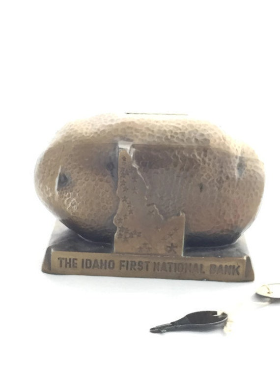Vintage advertising potato piggy bank with key idaho first for How to open a tin piggy bank