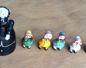 Tiny vintage governess and her charges - wooden dolls