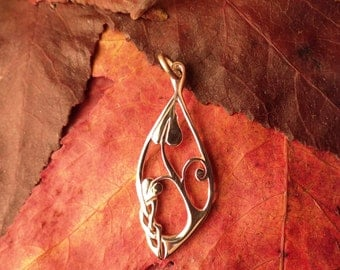 Sterling silver pendant, heart shaped leafed plant and celtic knot motif