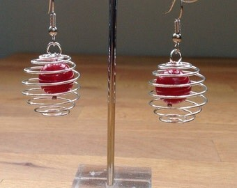 Red ball in silver spiral cage earrings