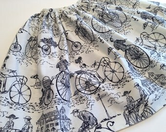 """1950's Pleated / Novelty Print / Black & White Skirt / Turn of the Century Bicycle Riders / Size Small / 25"""" Inch Waist"""