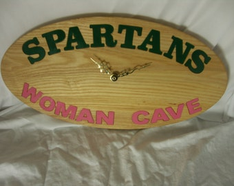 This is a Woman Cave Spartans clock.Very customizable. All natural wood. The grain will vary for all products as this is natural wood
