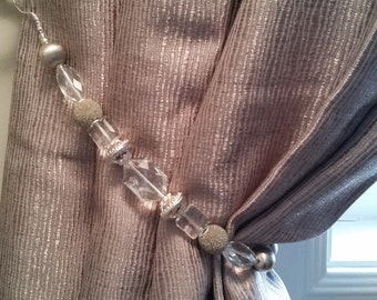 Beaded drapery tie-back with clear, taupe, silver & platinum coloured beads on silver wire. Classy!  Glam up your curtains!