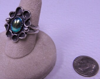 This ring is a treated glass size 6 1/2.