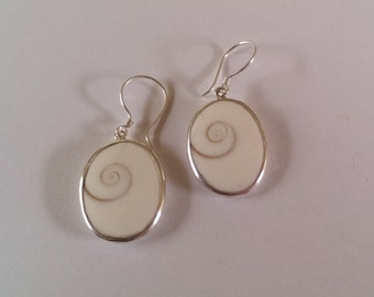 Handmade Solid 925 Sterling silver and shiva eye shell earring.