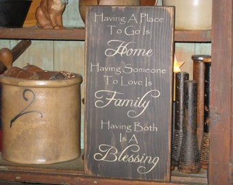 Having A Place To Go is Home Having Someone To Love Is Family Having Both Is A Blessing primitive rustic inspirational country sign