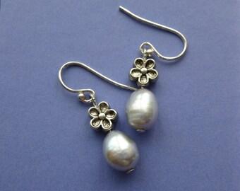 Handmade silver pearl earrings on  925 silver earring hooks.