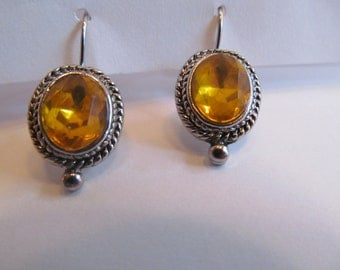 Vintage  silver tone  pierced earrings  with shiny yellow  stone  - dangling