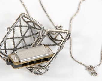 sterling necklace containing a Hohner miniature harmonica