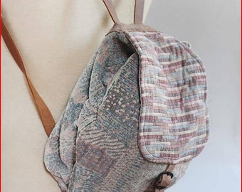 small backbag with leather details