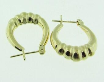 14 K gold small hoop earrings.
