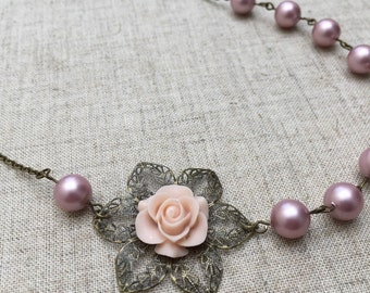 Dusty pink pearl necklace with dusty pink flower. Perfect for a bride or bridesmaid.