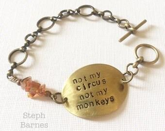 Not my circus not my monkeys bracelet in bronze with carnelian detail