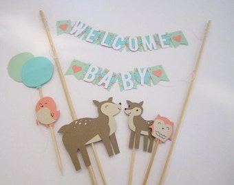 Baby shower paper bunting and critter cake toppers decorations