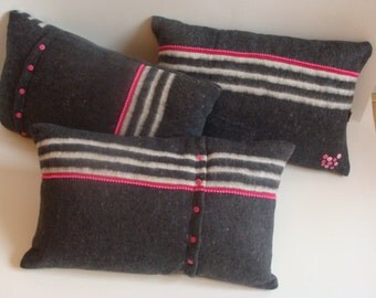 Cushions of moving blanket with pink accents.