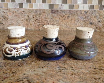 Small corked jars