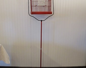 Birdcage on stand in red and near perfect condition.