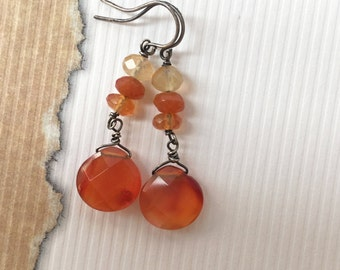 Carnelian shades of orange pear-shape, faceted semi-precious briolette and rondelle gemstones, oxidized sterling silver dangle drop earrings