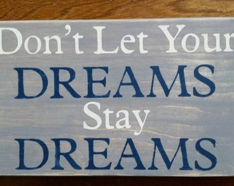 Don't Let Your DREAMS stay DREAMS sign.
