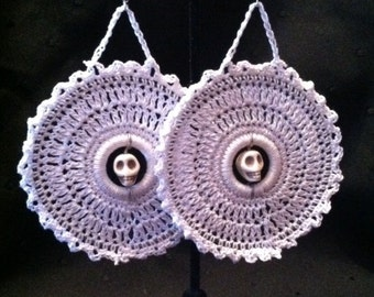 Large crocheted hoops with a skull bead center