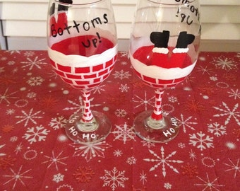 Santa bottoms up wine glasses!