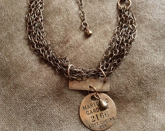Vintage coat check tag on brass chains.