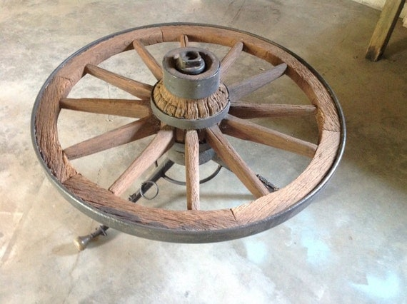 Items similar to antique primitive wagon wheel coffee table on etsy Antique wheels for coffee table