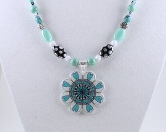 Minty Teal Flower Statement Necklace of my hand drawn art. Hand drawn design pendant with coordinated czech glass and silver beads on wire.