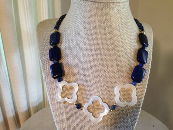 "20"" Lapis Lazuli necklace with Quatrefoil shaped Mother of Pearl accented gold plated beads."