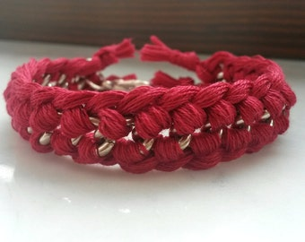 Red bracelet with silver chain and woven cotton thread