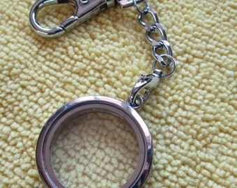 A round living locket key chain.