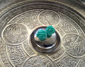 Sparkly teal Rose post earrings.